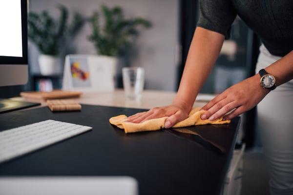 A man creates a clean workspace.