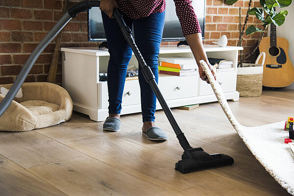 A woman vacuuming the floor